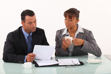 businessman and secretary consulting files