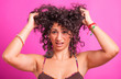 Young Woman with Curly Hairs on Fuchsia