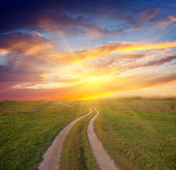 Fototapety path in steppe to sunset