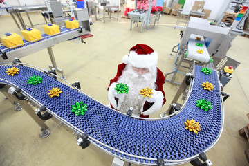 santa claus quality control manager at production line