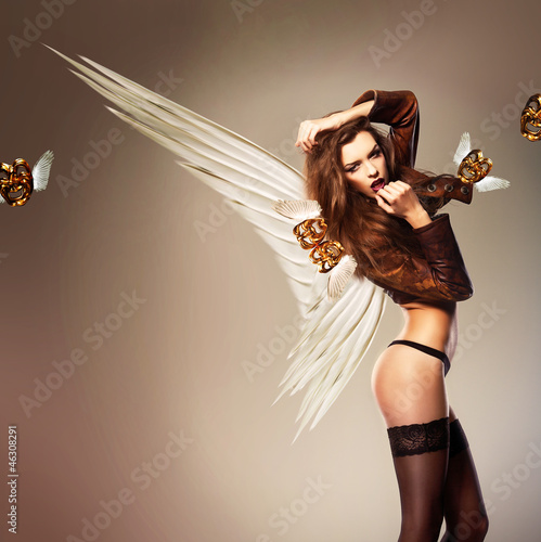 beautiful erotic woman with wings and flying masks