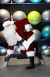 lively Santa Claus fitness training in gym