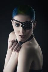 pretty woman with black eye-patch