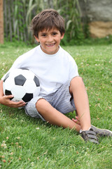 Little boy with a football