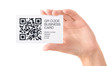 QR code business card in hand isolated