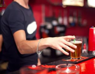 Barman making shoot cocktail at the night club