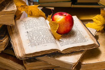 Old books apples and autumn leafs