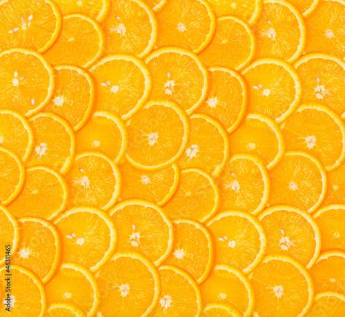 Plastry pomarańczowym tle