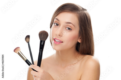 Woman holding make-up brushes