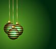 Boules rayées vertes et or sur fond de fêtes.
