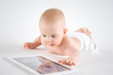 Baby  using a digital tablet