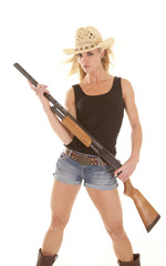 woman cowgirl with shotgun