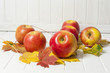 red apples and autumn leaves