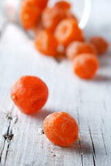 kumquat dried on a white wooden desk