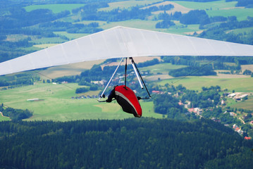 Top view of a flying man-gliding