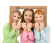 Three happy smiling kids looking through picture frame