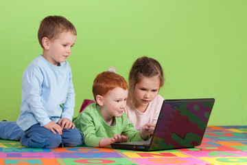 Group of children learning on kids computer
