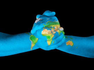Map painted on hands showing concept -world in our hands