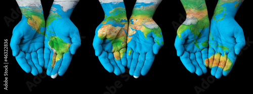 Nowoczesny obraz na płótnie Map painted on hands - concept of having the world in our hands