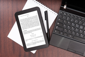 Laptop and digital tablet with mathematical article