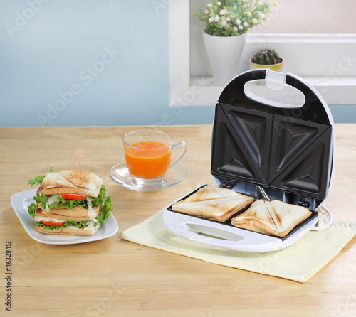 Sandwiches maker machine in the kitchen