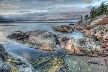 Rocky Shoreline On Grey Morning