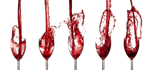 Collection of red wine glasses splashing out