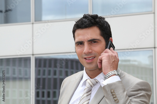Smart man talking on phone