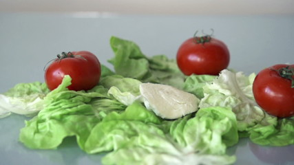 Mozzarella cheese falling on lettuce, slow motion shot at 480fps