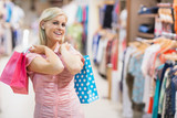 Woman smiling in clothes shop