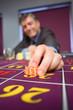 Man placing roulette bet