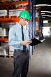 Supervisor Reading Book At Warehouse
