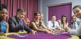 Smiling group at poker table