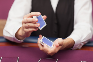 Dealer shuffling deck of cards in a casino