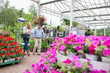 Couple with basket walking through garden center