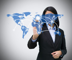 Businesswoman pressing world map hologram
