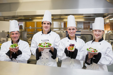 Chef's presenting different salads
