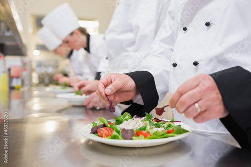 Chef garnishing salads