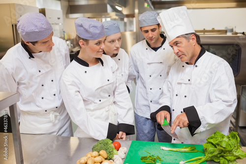 Trainees learning vegetable slicing