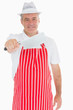 Butcher holding out meat cleaver