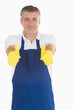 Man wearing apron giving thumbs up