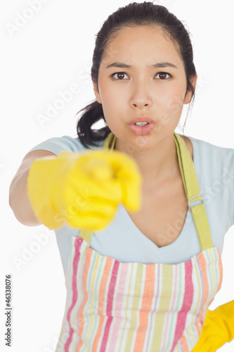 Accusing woman in apron pointing