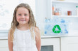 Smiling girl standing in kitchen