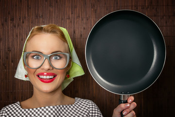Close-up funny woman cook with pan - vintage concept
