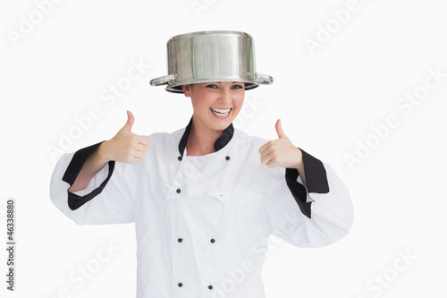 Cook having fun with a pot on her head