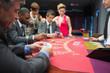 Man looking happily at his poker hand