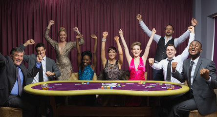 Cheering group at poker table