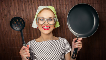 Close-up funny woman cook with pan and spoon - vintage concept