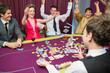 People celebrating at poker game