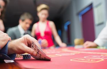Man lifting hand of poker
